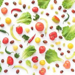 Food collage of fresh vegetables, top view. Corn, pepper, lettuce leaves, tomato isolated on white background. Abstract composition of vegetables. The concept of healthy eating. Food pattern.