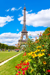 The Eiffel Tower and flowers on a beautiful summer day in Paris