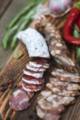 Sliced salami with rosemary and chili pepper.