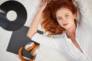 Woman listening vinyl at home