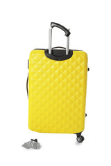 Yellow plastic luggage with broken handle and wheel isolated on white