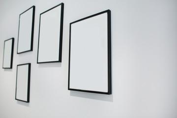 Blank photos frame on the wall