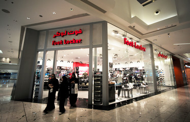 Local women are seen walking out from the Foot Locker store at Bahrain City Center in Manama