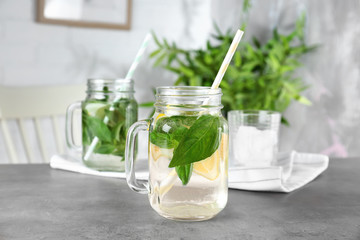 Jar with basil water on table