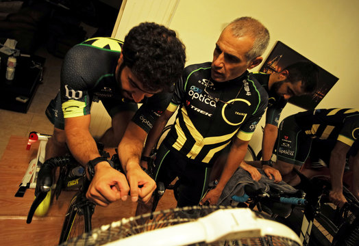 Bahrain tri-coach Jasim Al Bastaki instructs spinning class during a weekly training session at his club in Manama