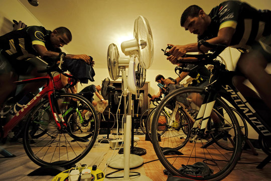 Triathlon enthusiasts are seen during their spinning class, set up by Greer Sansom, an Australian triathlon coach during their weekly training session at her club in Manama