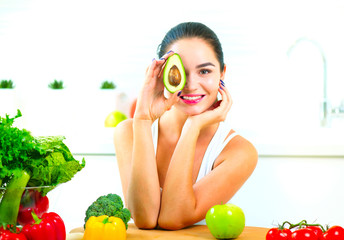 Beauty young joyful woman holding fresh avocado. Healthy eating concept
