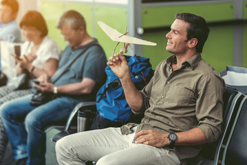 Pleasant happy guy is waiting for flight