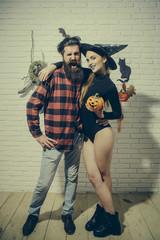 Halloween girl smiling with pumpkin