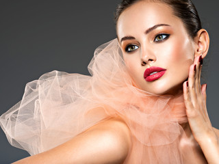 closeup face of a fashion woman with stylish makeup, red nails and lips