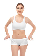 Beautiful young woman in underwear on white background. Diet concept