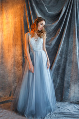 sweet bride in an blue gown