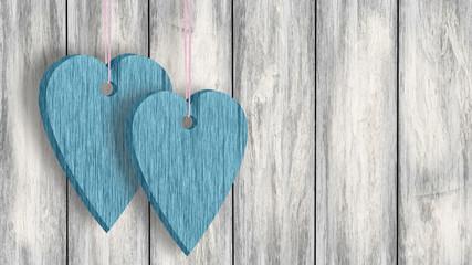 Dwa serca na sznurku na tle desek