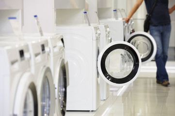 washing machines in appliance store and defocused buyer