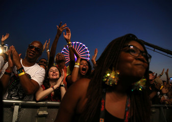 People cheer during a concert at the Rock in Rio Music Festival in Rio de Janeiro