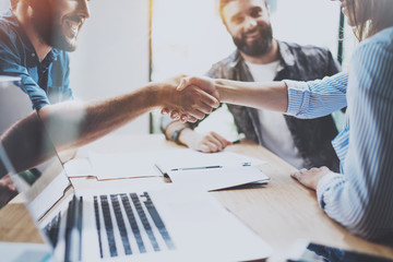 Business partnership handshake concept.Photo coworkers handshaking process.Successful deal after great meeting.Horizontal, blurred background.