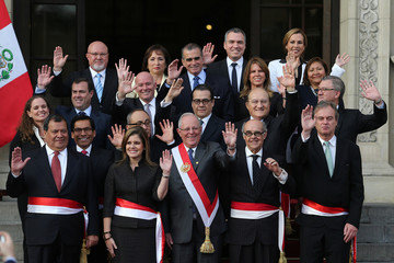 Peru's President Pedro Pablo Kuczynski (C) poses with newly sworn-in ministers after a ceremony at the government palace in Lima