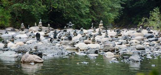Dozens of cairns dot the waterhole along Englishman River