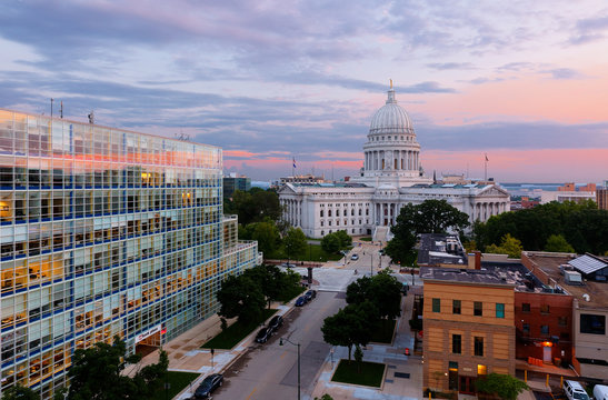 Bird's eye view of the Wisconsin state capital at sunset.  The building houses both chambers of the Wisconsin legislature along with Wisconsin Supreme Court .