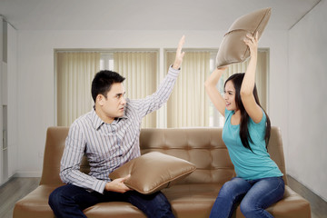 Young woman quarrel her husband on the couch