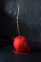 red candy apple on dark rustic background