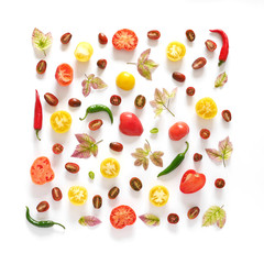 Food collage of fresh vegetables, top view. Tomatoes in a cut, pepper, autumn leaves isolated on white background. Abstract composition of vegetables in a square format. Сoncept of healthy eating.