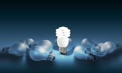 Glowing bright light bulb among others, different and leadership concept