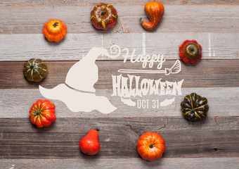 Pumpkins on wooden background. Halloween. Autumn concept