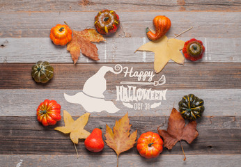 Pumpkins and fall leaves on wooden background. Halloween. Autumn concept