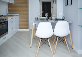 Modern kitchen interior with served table