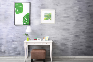 Modern room design with framed pictures of tropical leaves
