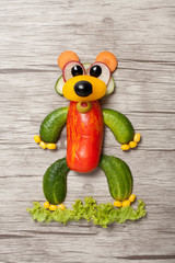 Bear made with vegetables on wooden background