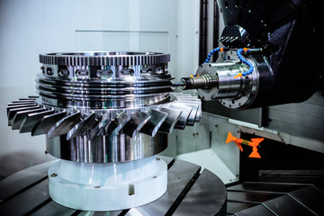 A modern CNC milling machine makes a turbine wheel.