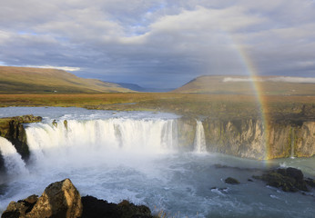 Rainbow over Godafoss waterfall in Iceland