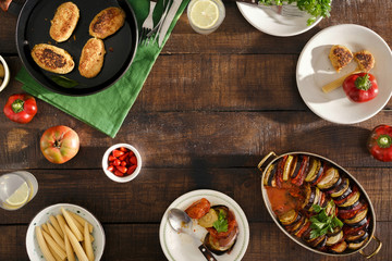 Frame of Different vegetarian food. Ratatouille, chickpeas cutlets, lemonade, snacks
