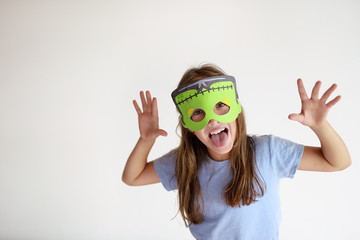 The girl plays in a self-made mask of Frankenstein