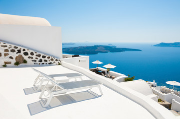 Two sunbeds on the terrace. Santorini island, Greece.