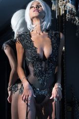 Woman in white wig and black lingerie