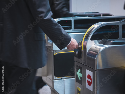 People insert ticket to Ticket Entrance at Subway station