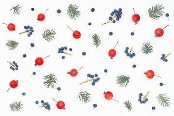 New Year's patternc made of blue berries, paradise apples, spruce branches. White background, top view, flat lay.