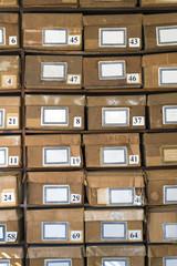 old cardboard boxes fill shelves
