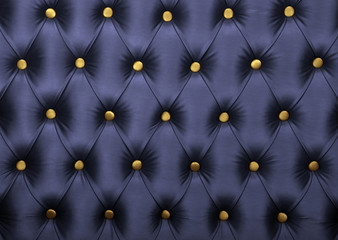 Dark blue capitone with golden buttons texture