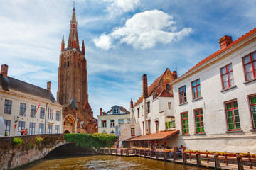 Foto op Canvas Brugge Canals of Bruges (Brugge). Church of Our Lady, Onze Lieve Vrouw Brugge