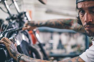 Mechanic man repairs motorcycle