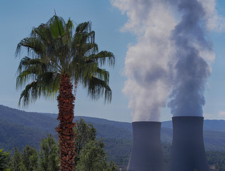 Smoking pipes of thermal power plant against blue sky. Stop to environmental pollution