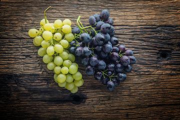 Grape. Bunch of multicolored grapes on rustic wooden table Fototapete