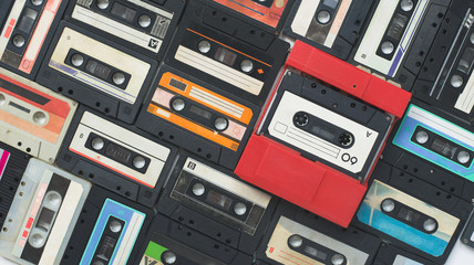 Colored background of old vintage cassettes of the 60-80s
