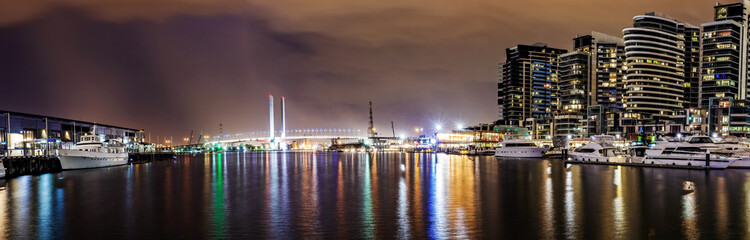 Panorama view of a beautiful view of docklands and The Bolte Bridge at night in Melbourne Australia..