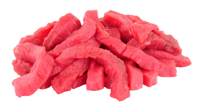 Fresh raw stir fry beef strips isolated on a white background