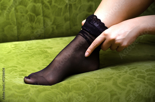 Sexy Female Feet In Black Stockings On Green Sofa Woman Clothe Stockings On Her Legs